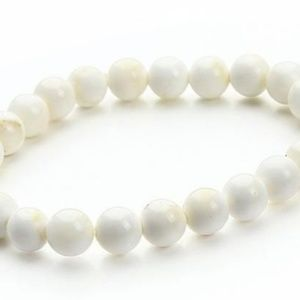 Hand carved white tridacna shell bracelet